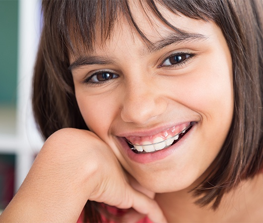 girl smiling with retainer on