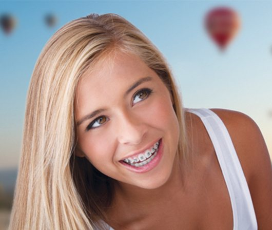 Blonde teen girl smiling with braces