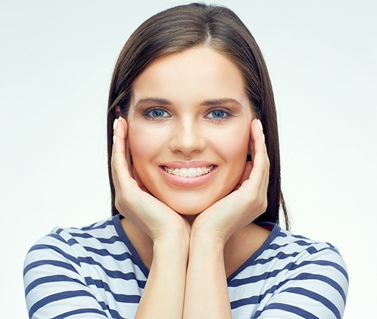 woman with braces framing face