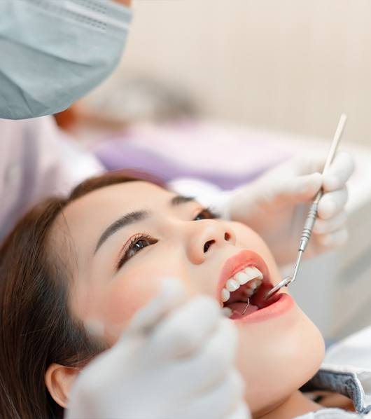 woman laying back in orthodontic exam chair